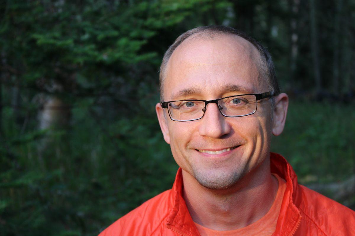 john in orange shirt